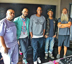 Jay-Z posing with Producers from his music project, Magna Carta Holy Grail.  The album releases on July 7, 2013.